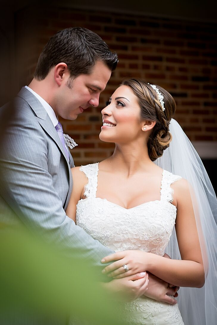 Dana wore her hair in a chignon with a braid crown on her wedding day. Over the crown, she wore an elegant crystal-embellished headband.