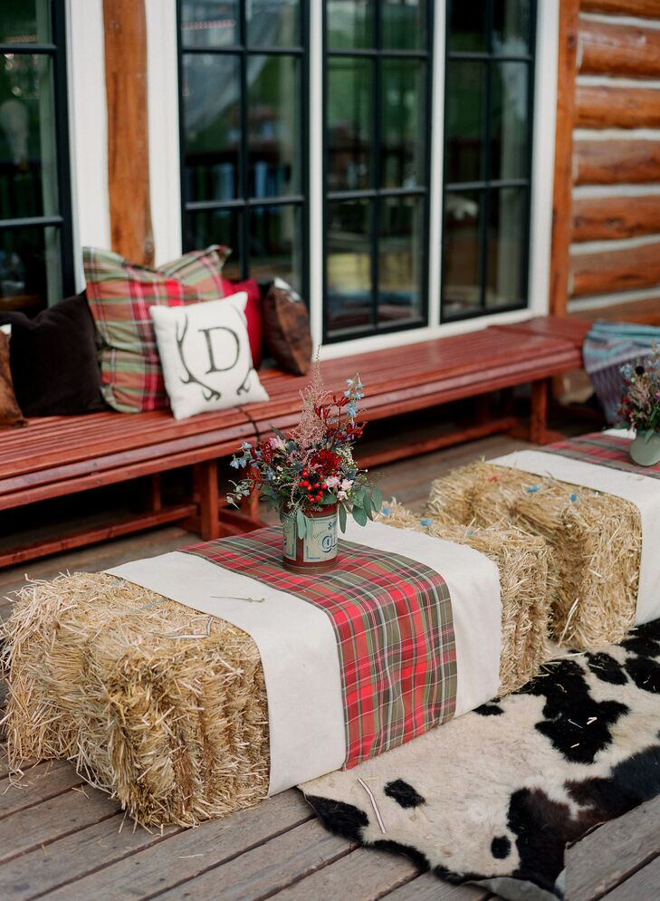 The lounge area was set up on the front balcony outside of Beano's Cabin. They included hay bales decorated with signature plaid wrapped around them. The wooden benches were decorated with signature monogrammed logo pillows, plaid pillows and cowhide pillows with a large cowhide rug under the haystacks.