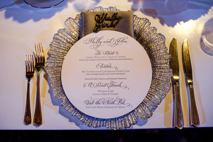 Each guest's name waited at the place setting in three-dimensional glittery calligraphy. A round menu atop a silver charger displayed the dinner courses as well as a hint to the North Pole-themed surprises later in the evening.