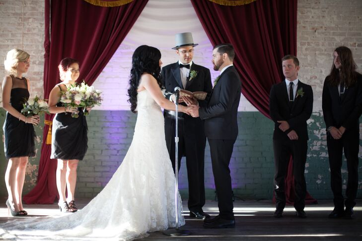 """Simplicity was the goal when it came to the ceremony decor. """"We dropped subtle hints of what to expect upstairs, such as red curtains and the top hat worn by our officiant,"""" Ashley says. """"But for the most part, we wanted people to be surprised by the contrast of the ceremony and the rest of the wedding."""""""