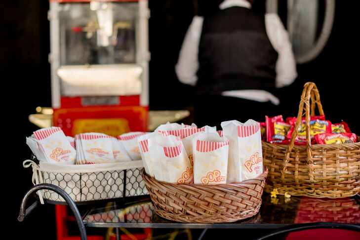 A popcorn station with old-fashioned popcorn bags provided snacks for guests throughout the evening at Inn at the Old Silk Mill in Fredericksburg, Virginia.