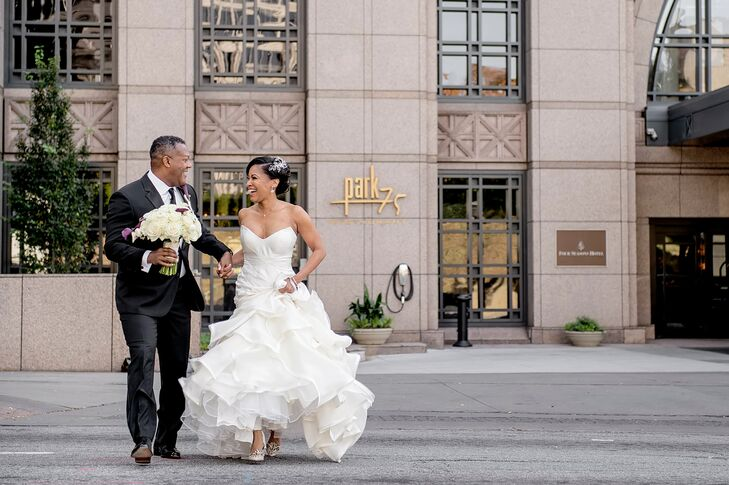 """""""Nick and I are city dwellers,"""" Angela says. """"We love Atlanta city life, and we wanted a venue that highlighted the beautiful skyline and energy of midtown Atlanta."""" The couple chose the Four Seasons Hotel for their black-tie affair since they could have a rooftop ceremony and ballroom reception. For the couple's first look, Angela and Nick met on 14th Street, and they strolled hand in hand through the city."""