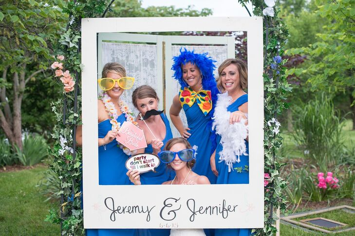 A photo booth with playful props was set up at the reception.