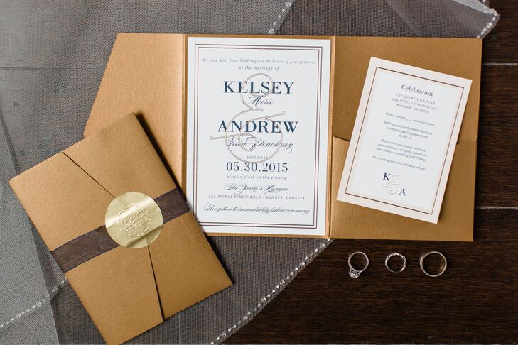 Kelsey designed the gold and navy stationery from a template on Wedding Paper Divas. Kelsey and Andrew made them extra-special by placing the invitations in a trifold with a pocket that had how many seats were reserved in each guest's honor and the details of the reception.