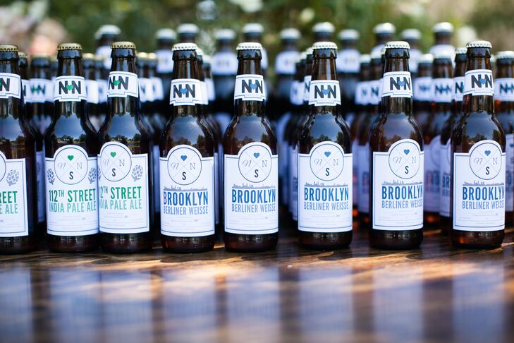 Guests were given home-brewed beer that were capped and decorated with the couple's logo for the wedding day. The beer names were inspired by New York, from 112th Street IPA to Brooklyn Berliner Weisse.
