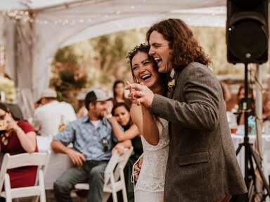 Indie bride and groom dancing at outdoor wedding reception