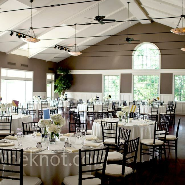 White table linens and dark wood chiavari chairs were an elegant complement to the unique architecture of the club.