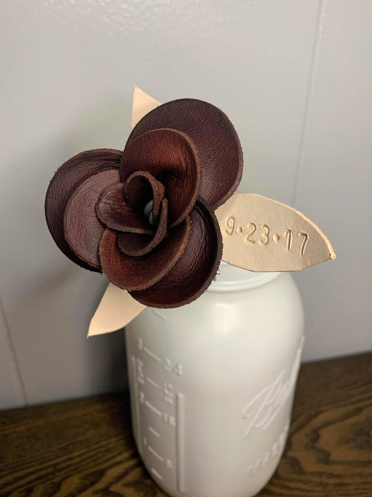 Brown leather flower with cream leather leaves featuring special date