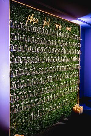 Escort Card Display on Hedge Wall