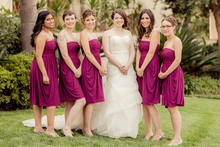 The bridesmaids wore strapless jersey knit dresses in a vibrant berry red.  The bride wore a strapless, multi-layered gown with a beaded belt sewn in for extra sparkle. She borrowed a diamond necklace that had belonged to her grandmother and had been used in other family weddings.
