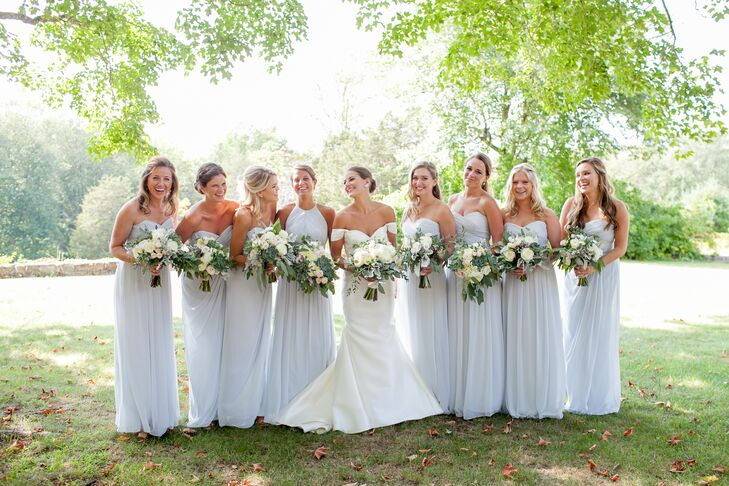 Rebecca had her bridesmaids wear the same gown: a floor-length, strapless style from Dessy Group in a cool, frost blue hue. The girls accessorized with gold diamond bracelets, a gift from Rebecca, and simple drop or stud earrings.