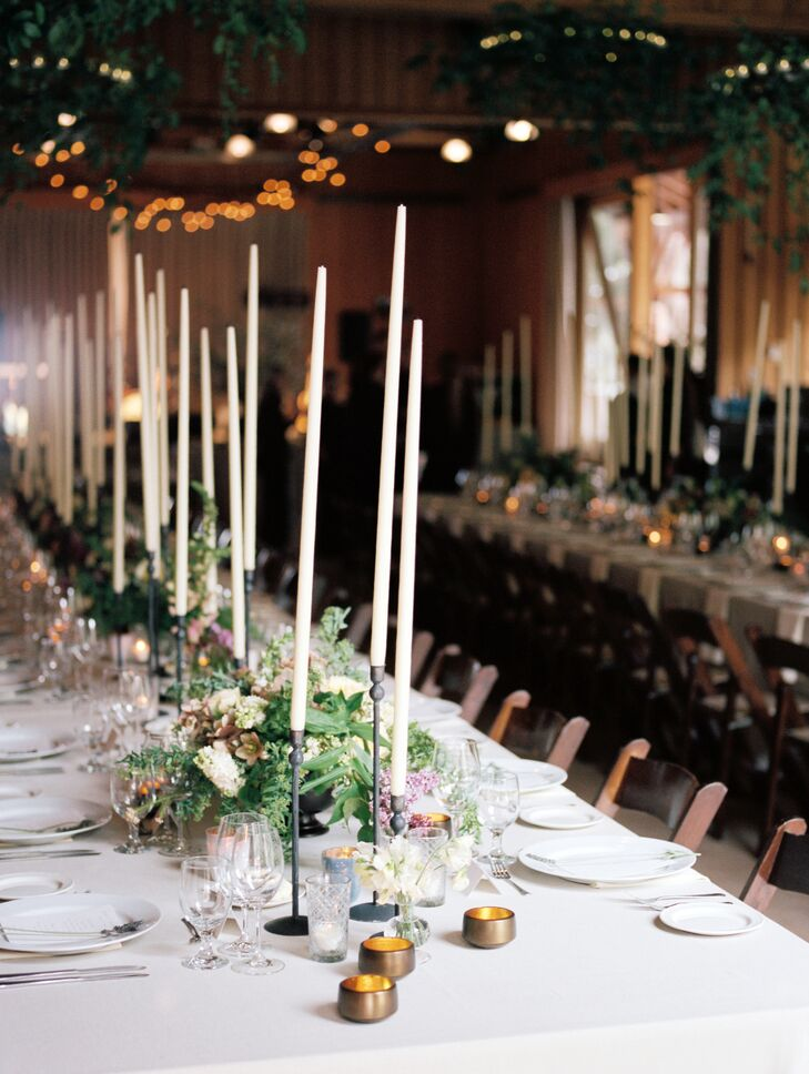 Tall, white candles lined the length of each dining table for an elegant look. The table numbers were written in gold ink on ethereal chunks of agate, imitating the steep peaks of the Alpine landscape.