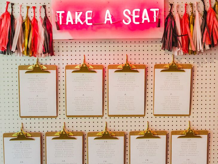 Seating arrangements are found on clipboards on a bright wall