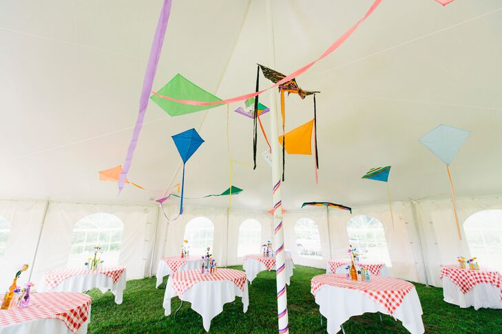 The couple decorated their backyard tent with colorful hanging kites, a nod to a hobby they enjoy together. Kites also appeared on their invitations.