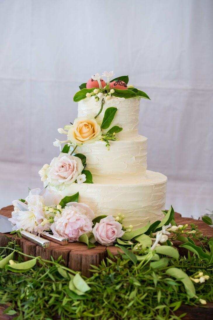 Three-Tier Buttercream Wedding Cake with Cascading Flowers
