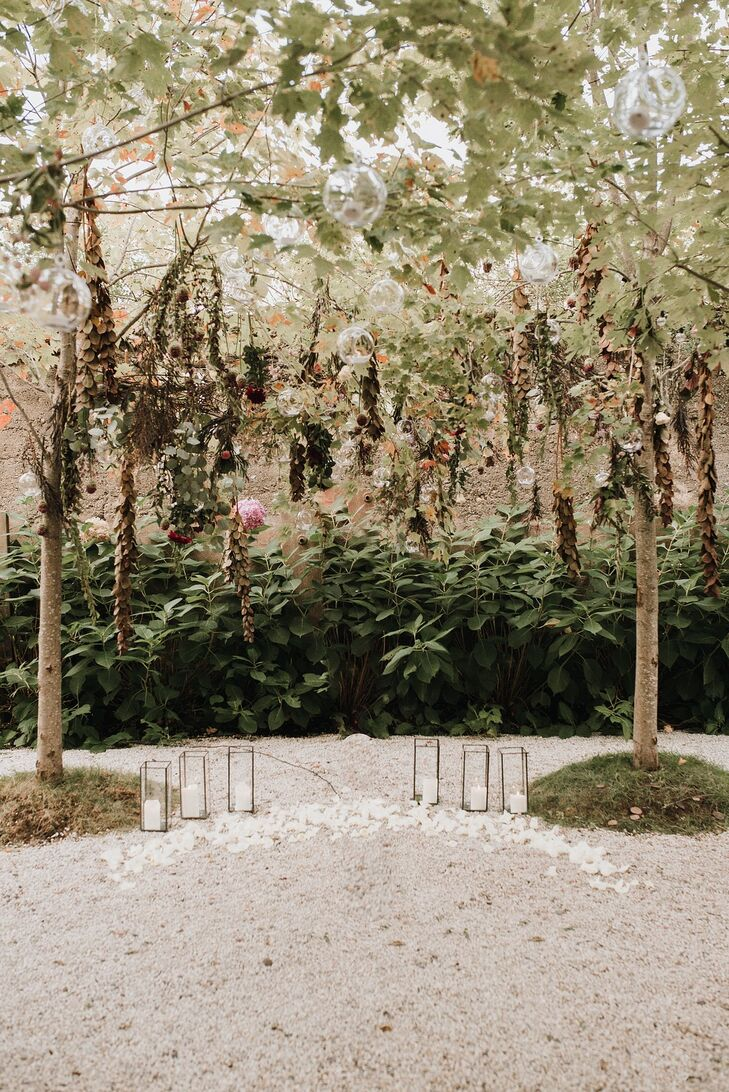 Rustic Ceremony Site with Modern Flower Arch and Candles
