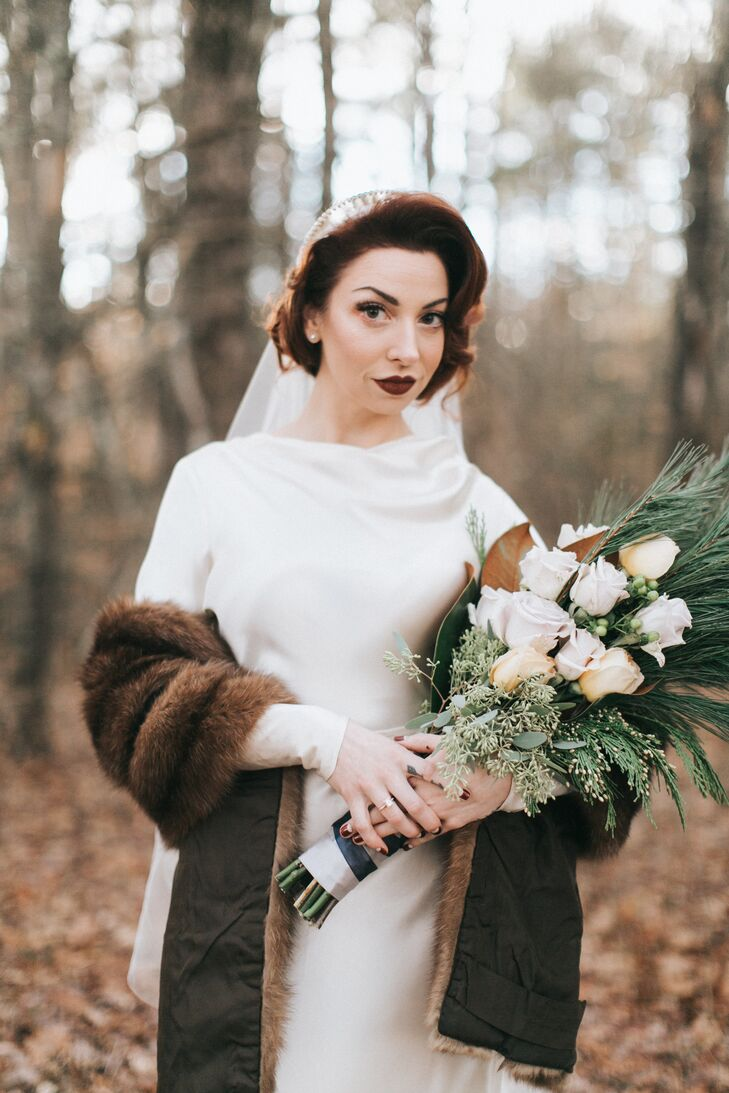 Lexie's bridal look was the picture of vintage glamour. The bride wore her long locks in a late-1930s curled updo and opted for makeup—which she did herself!—in shades of brown, copper and pink to match her vintage fur wrap and the wooden decor elements.