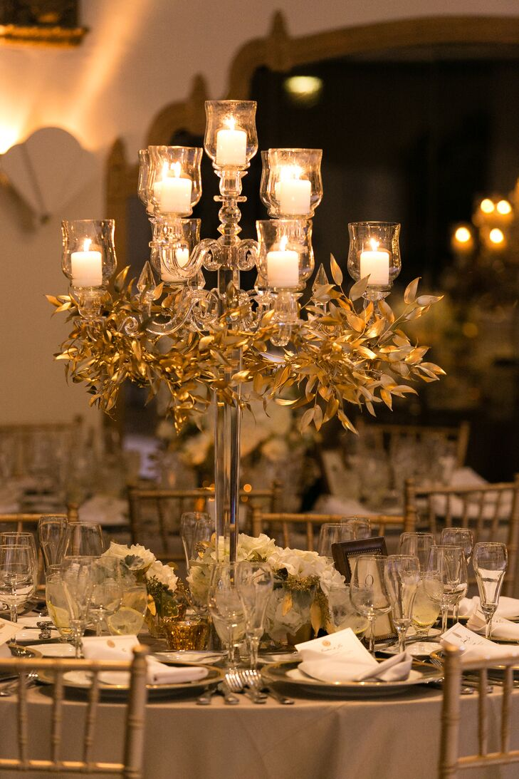 """Sarah from Vale of Enna really blew me away with our centerpieces,"" Jordan says. Sarah transformed the bride's idea of romantic and lush into tall crystal candelabras with gold foliage and low centerpieces with flowers and candles."