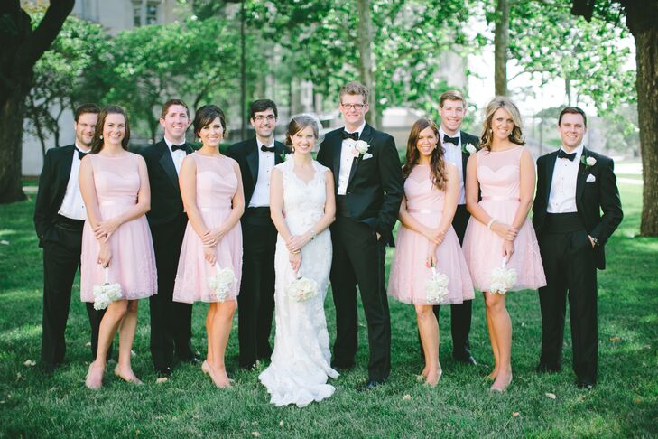 The bridesmaids wore knee-length A-line pink dresses for the classic, romantic wedding. Genevieve loved the illusion neckline, satin sashes and the subtle detailing on the skirts. The David's Bridal gowns totally complemented her look too.