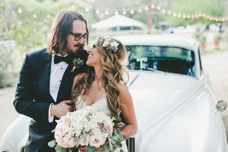 Marisa had ivory and pink roses pinned into her long wavy hairstyle, elegantly draping over the top of her ivory Marisa Bridals dress. Marisa held a romantic arrangement of ranunculus, roses, peonies and veronica.
