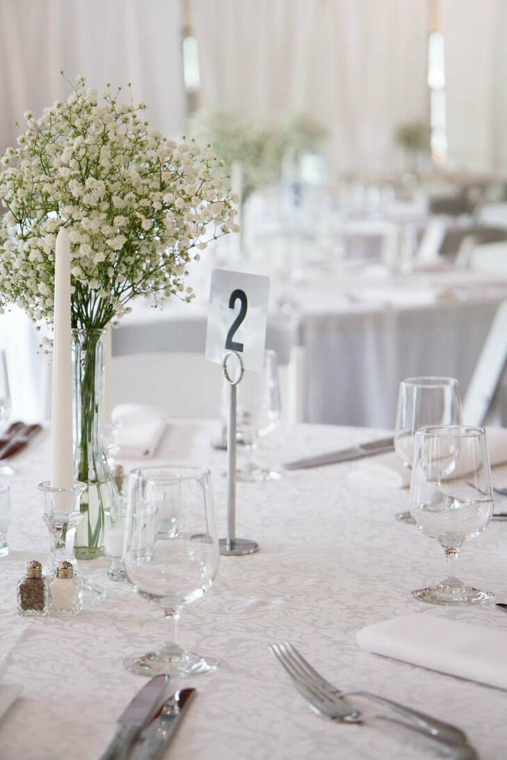 Large bouquets of baby's breath made for striking centerpieces against the all-white reception decor.