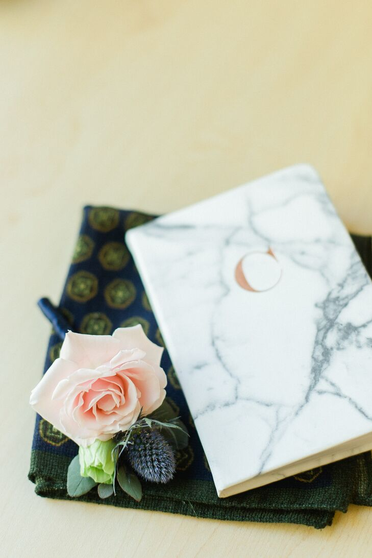 Blue Thistle Boutonniere and Marble Vow Book