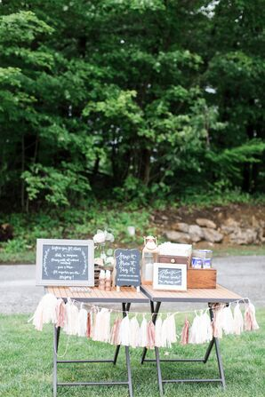 Ceremony Welcome Table With Pom-Pom Banner