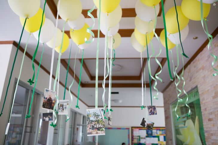 Yellow And White Balloons Floated Inside The Reception E With Dangling Green Ribbon