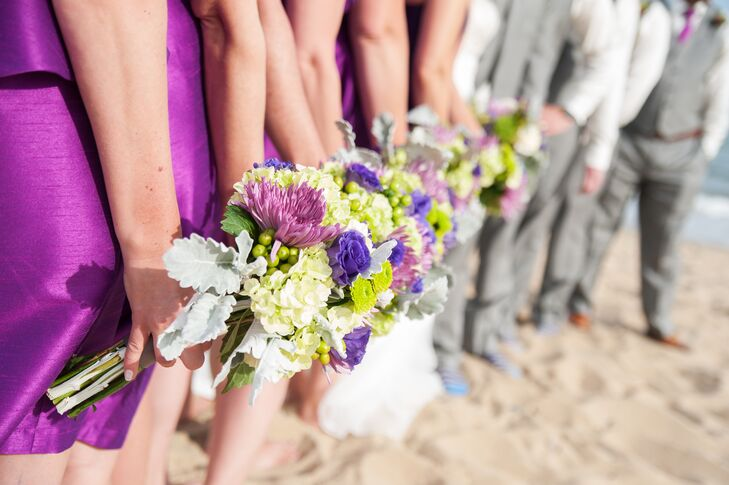 The bridesmaids carried bouquets with purple and green chrysanthemums, viburnum, dusty miller, indigo roses and hypericum.
