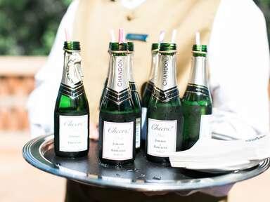 Waiter serving champagne bottles at a wedding