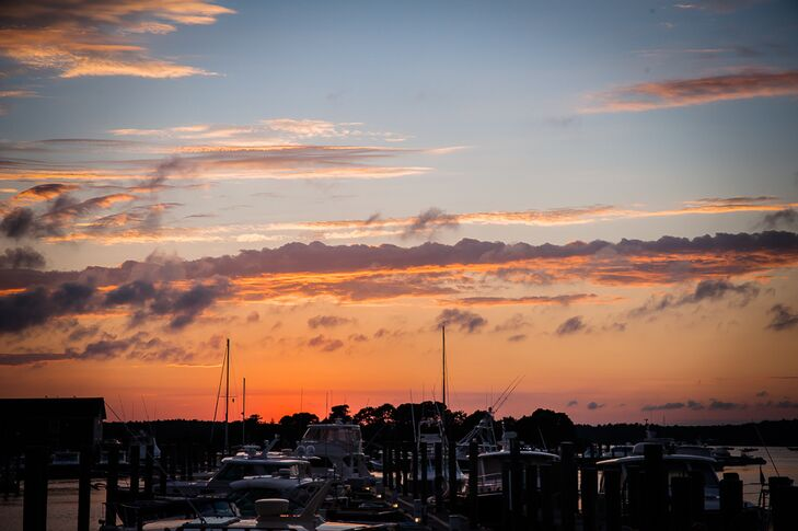 The bride and groom chose the Nauticus Marina in Osterville, Massachusetts out on the cape because of the amazing views, where their guests could enjoy the ocean and sunset during the reception.