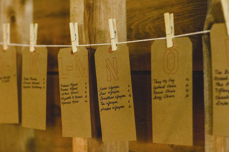 The couple made their own escort cards--brown gift tags clipped to string by clothespins.