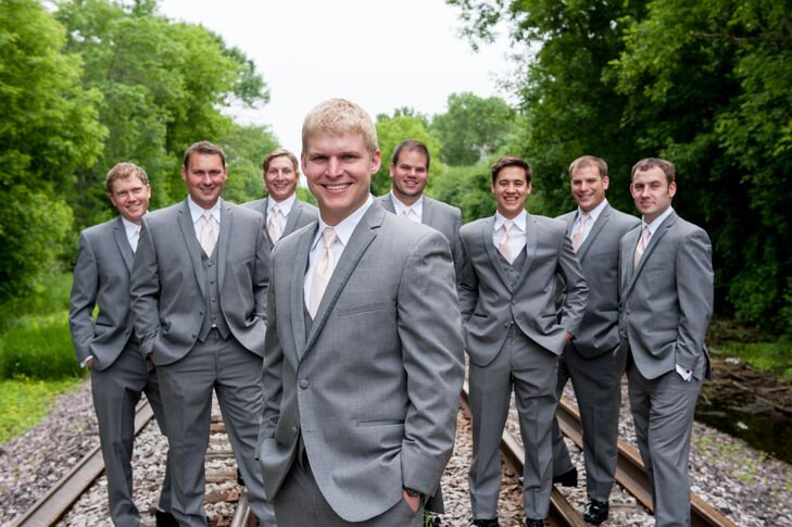 Andy's groomsmen wore dark gray tuxedos with blush ties. Andy even won the tuxedos at a bridal show that Amber admits she forced him to attend.