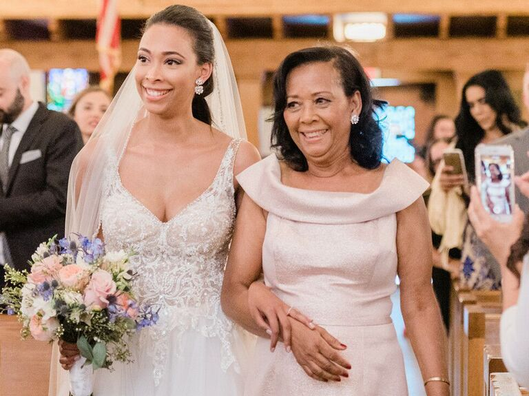 Bride and mother of the bride during wedding ceremony