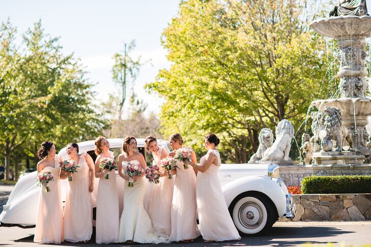 """The bridesmaids wore blush one shoulder dresses by Amsale, which were purchased at Nordstrom Bridal Boutique. """"These dresses worked perfectly for all my bridesmaids, who are of different shapes and sizes,"""" says Erin. """"Amsale nailed it."""""""