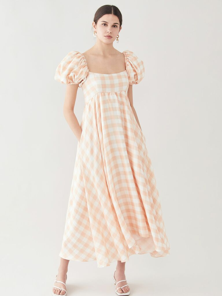 peach gingham print dress with puffy sleeves