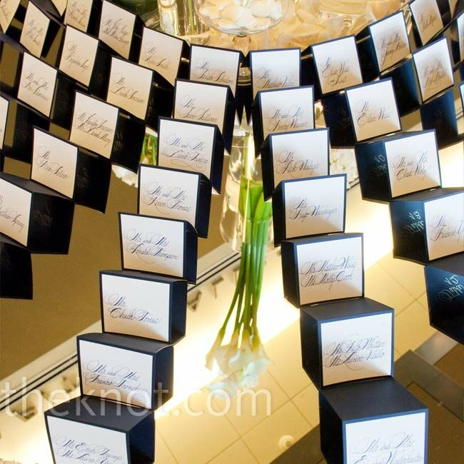 Elegant calligraphy made the white escort cards simple, yet stunning.