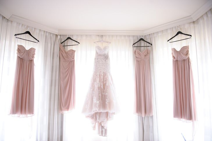"""""""Once I found the perfect color I told the girls to pick any long style they liked,"""" Melissa says. Her four bridesmaids wore blush floor-length dresses with empire waists and sweetheart necklines. Each woman matched the pleating on their skirt with either a strapless, one-shoulder or off-the-shoulder style."""