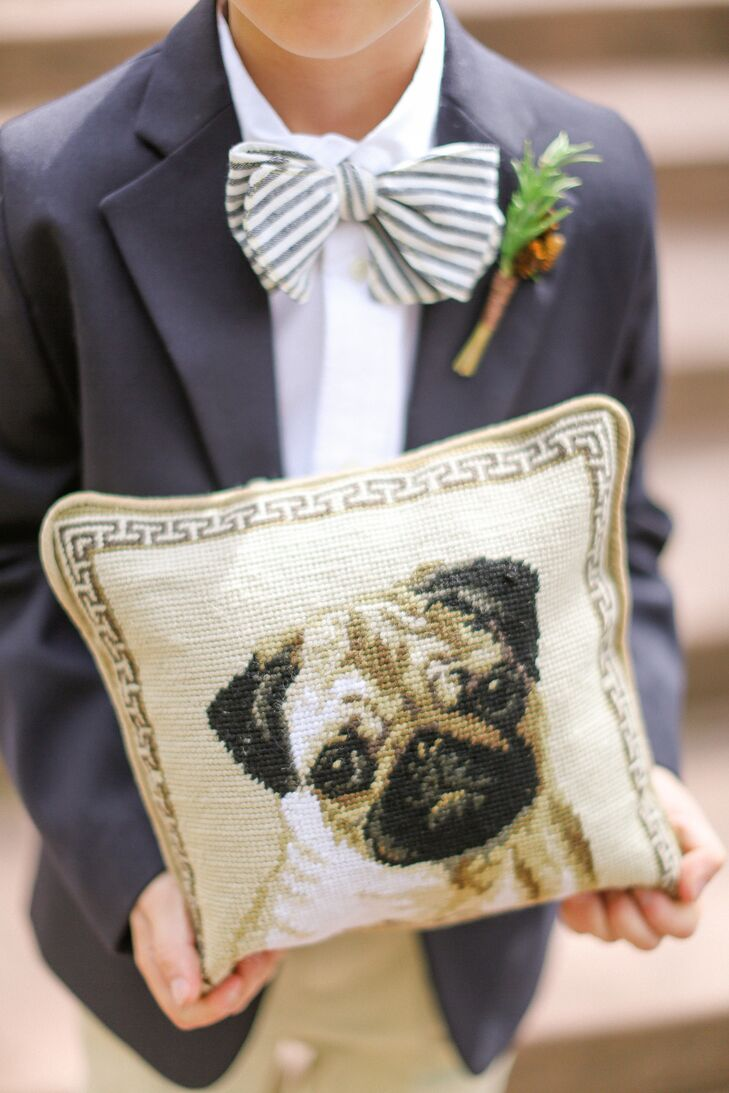 """""""Since our beloved pug was not allowed up at Beano's we wanted as many ways to incorporate him into our wedding,"""" Stacey says. The dog, Frank, was present during the first look and adorned the ring pillow so he could be with the couple down the aisle."""