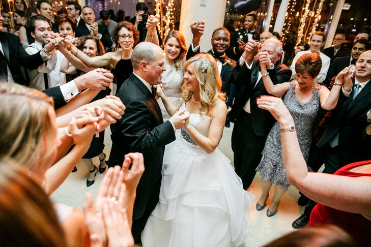 In honor of Eli's Jewish faith, Megan and Eli danced the Israeli hora at their reception, surrounded by family and friends. They spent the rest of the night dancing to the award winning Vincent James Band.