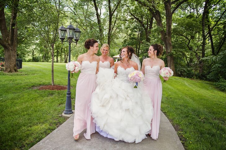 The bridesmaids wore Jim Hjelm floor-length blush chiffon dresses for a soft, classic look.