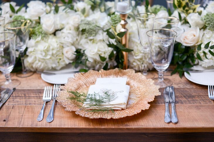 Place Setting with Gold Charger and Monogramed Napkin