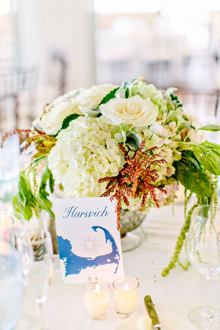 Instead of traditional table numbers, Katie and Louise played up the wedding's beachy theme by naming each table after a town in Cape Cod. The names were displayed on cards designed by Ruth Bleakley of Concertina Press and featured a navy blue map of Cape Cod in the style of those on the couple's invitations.
