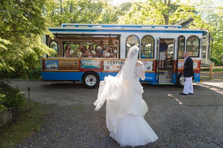 Veil and dress blowing in the New England summer breeze, Sarah meets her bridesmaids to take a classic trolley ride to the wedding venue.