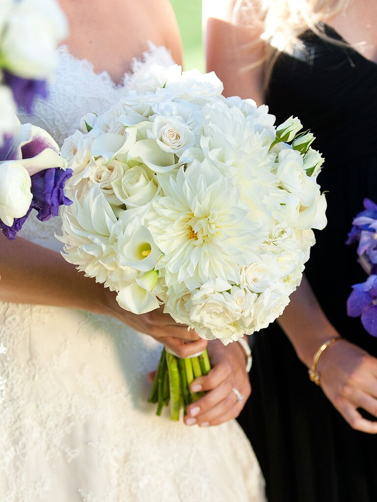 White wedding bouquet with roses and dahlias