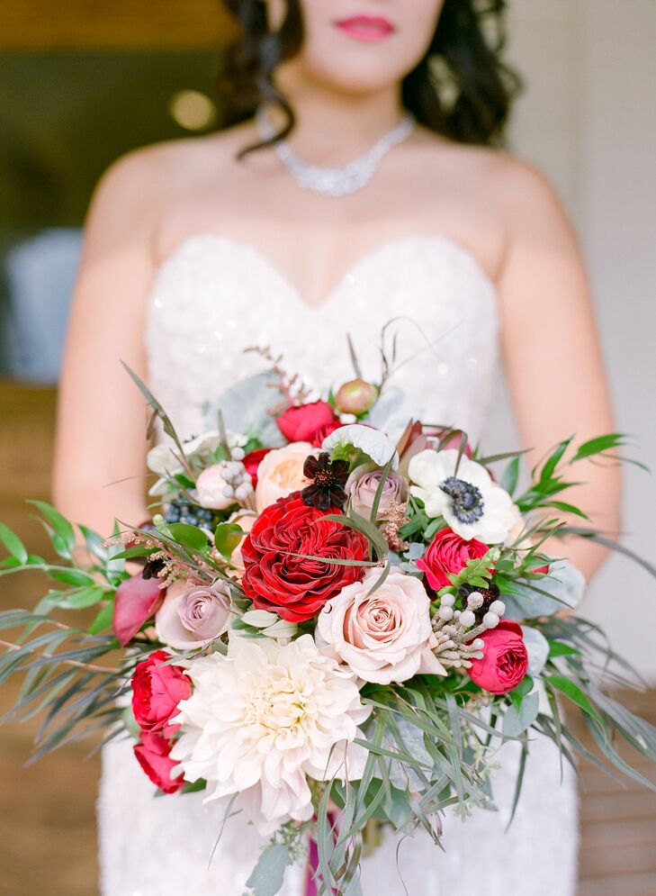 "Marina's bouquet was a mix of pink and red garden roses and greenery. ""I didn't want to stick to just one type of flower, so I told the florist to get anything that screamed romantic vineyard."""