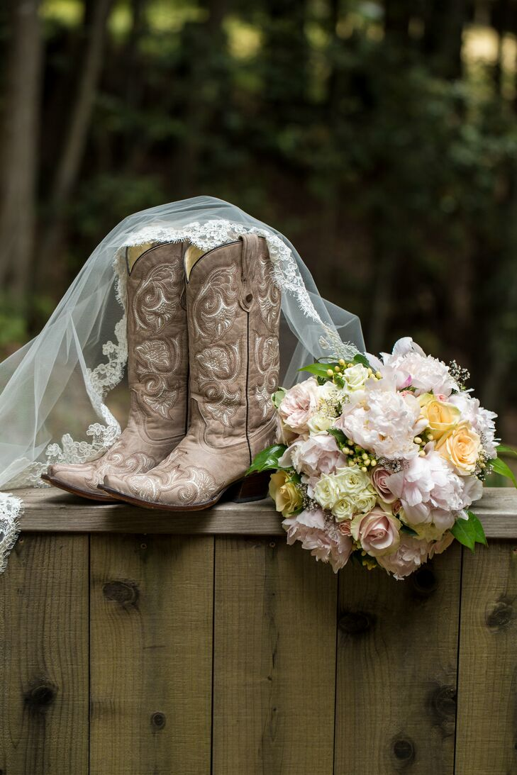 Allyson accessorized her traditional lace Monique Lhuillier gown with a lace-edged veil, brown cowboy boots and a bouquet filled with yellow, ivory and pink blooms.