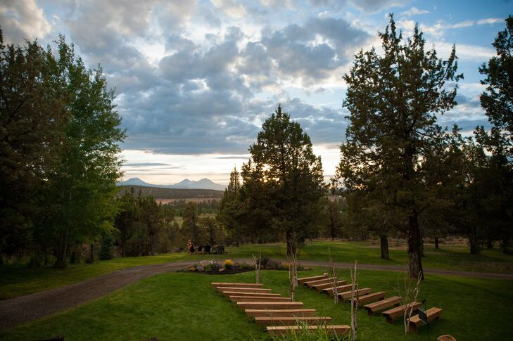 The ceremony was set at a private residence and used long wooden benches, tree branches and the natural mountain view backdrop for a rustic design.