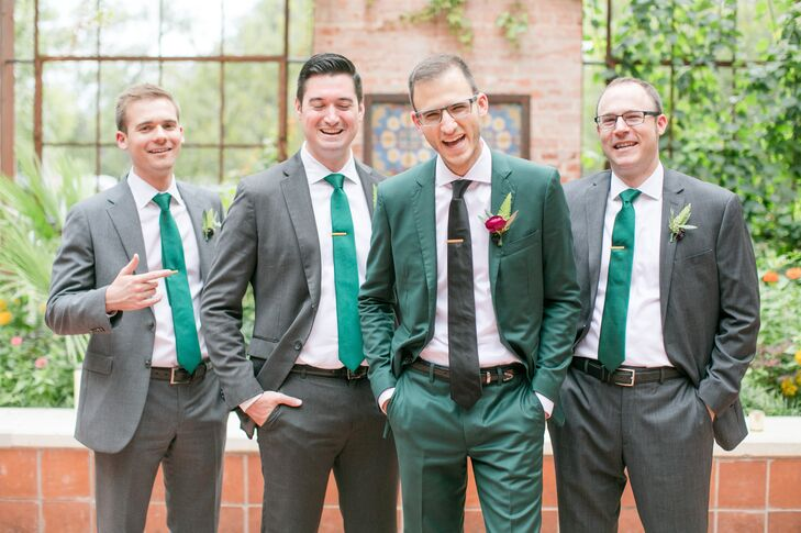 Groom in Emerald Green Suit with Groomsmen in Grey Suits