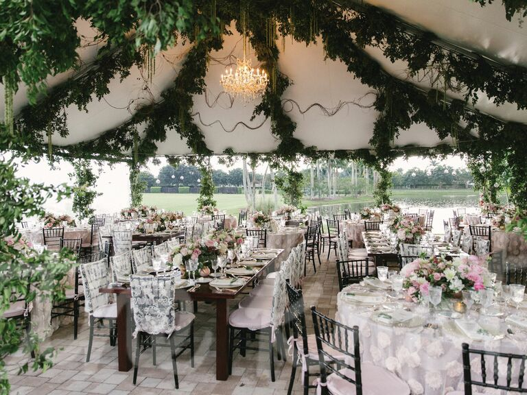 Garland-draped ceiling of outdoor wedding tent